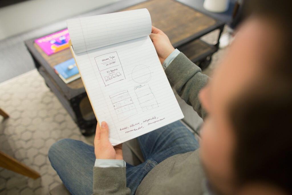 Man reviewing notebook